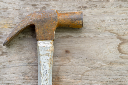 old hammer on wood background