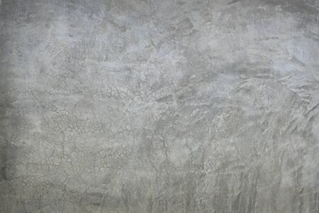 abstract background of old gray cement surface with cracks Imagens