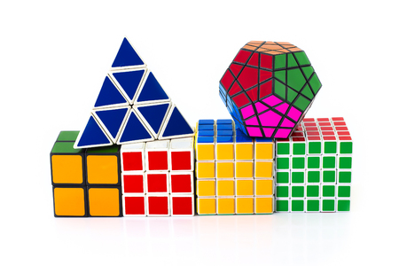 invented: PHRA NAKHON SI AYUTTHAYA THAILAND JUNE 30.Rubiks Cube invented by a Hungarian architect Erno Rubik in 1974.Rubiks cube  pyramid and megaminx on a white background. In Phra Nakhon Si Ayutthaya Thailand on 30 June 2015.