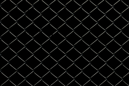 wired: Wired fence on a black background.