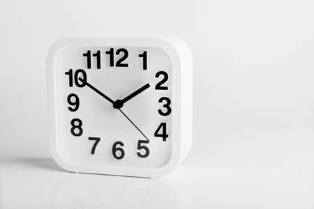 beat the clock: clock white colour on isolated white background