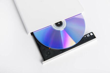 optical disk: Image of white external cd dvd burner reader isolated on white