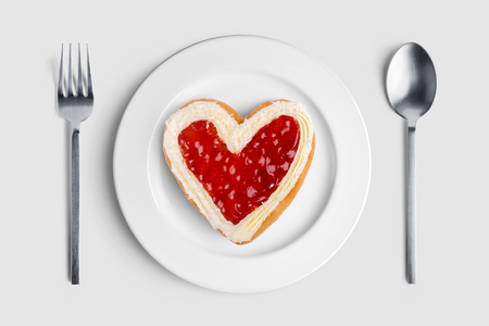 Heart shaped donut on white plate for valentines day with clipping path Imagens