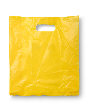 Yellow plastic bag on white and shadow with clipping path