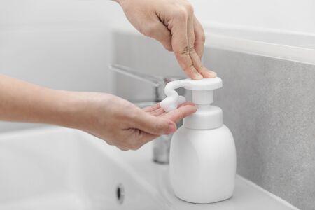 Woman using liquid soap to wash hands, hygiene to protective pandemic coronavirus, Close-up.