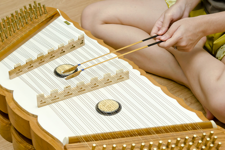 hammered: Girl plays Hammered Dulcimer - Traditional Thai music instrument