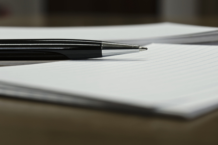 Pen and white paper close-up view