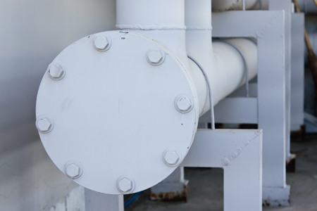 flange: Potable water piping with flange, stud, bolt on a condominium Stock Photo