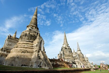Old buddha pagoda temple with cloudy white sky in Ayuthaya Thailand