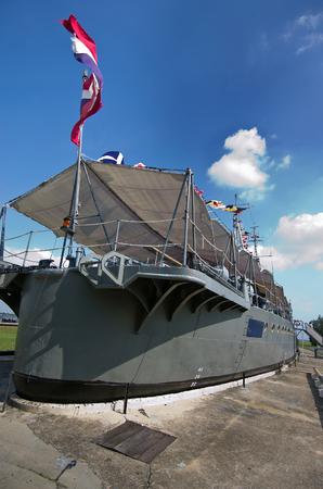 settled: Old warship settled on the cement ground as museum in Samut Sakohn, Thailand Stock Photo