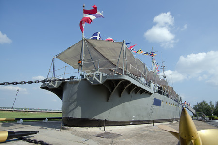 Old warship settled on the cement ground as museum in Samut Sakohn, Thailand Stock Photo