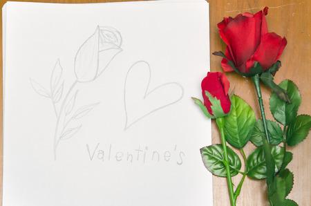 lapiz y papel: Rosas y gráfico de la mano del corazón para el evento de San Valentín Foto de archivo