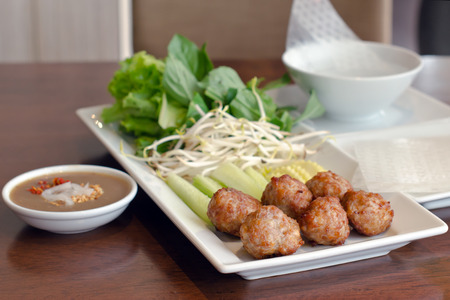cooked pepper ball: Nham nueng Local name Vietnamese meatball and vegetable wrap