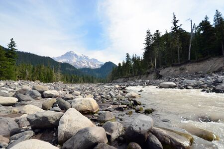 mount rainier: View of rock, river in front of mount rainier national park USA