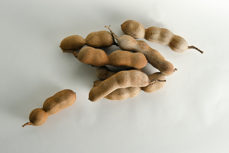 cucurbitaceae: Pile of bitter gourd (Other names are Cucurbitaceae, balsam apple, balsam pear, bitter cucumber, bitter melon, tamarind) isolated on white background