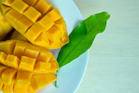 nicely: Beautiful nicely cut yellow mango with leaf