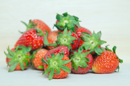 fragaria: Strawberry, Group of red ripe strawberry fruit on wooden board (Other names are Fragaria, strawberry, Fragaria ananassa) Stock Photo