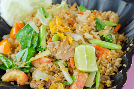 china cuisine: Fried rice with tomato, lime and vegetables