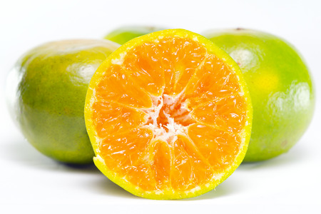 Orange fruit (Other names are Les Oranger, sweet orange, citrus sinensis, Citrus aurantium, Citrus maxima, Citrus reticulate, mandarin orange) with half view isolated on white