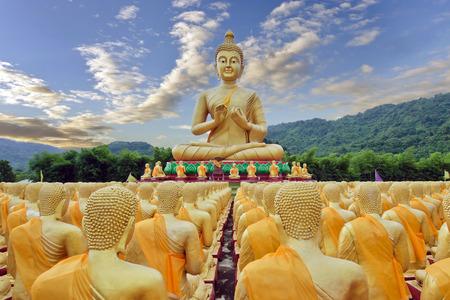 budda: Buddha statue with sky and mountain at Buddha Maka Bucha park temple Nakohn Nayok, Thailand Stock Photo