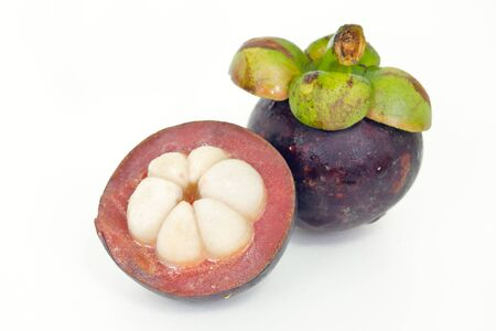 Mangosteen (Other names are garcinia, mangostana, clusiaceae, saptree, purple mangosteen, monkey fruit, Malpighiales) fruit with half cross section isolated on white