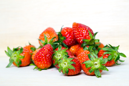 fragaria: Group of of red ripe strawberry fruit on wooden board (Also known as Fragaria strawberry, Fragaria ananassa) Stock Photo