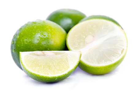Lemon fruit (Other names are lime in French, citrus fruit, lime green, Key lime, Persian lime, Kaffir lime, desert lime) with half cross section and partial section isolated on white