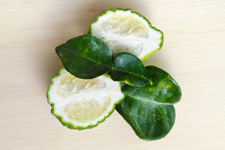 rutaceae: Bergamot (Also known as Kaffir lime, Citrus lime, Citrus bergamia, Citrus, Bergamot, Magnoliophyta Rutaceae) fruits with leaf
