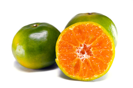 citrus maxima: Orange fruit (Other names are Les Oranger, sweet orange, citrus sinensis, Citrus aurantium, Citrus maxima, Citrus reticulate, mandarin orange) with half view isolated on white background Stock Photo