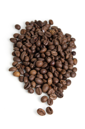 Heap of roasted coffee beans isolated on white