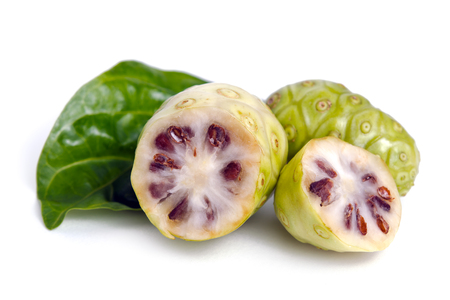 noni fruit: Noni (Also named as Morinda Citrifolia, Rubiaceae Noni, great morinda, indian mulberry, beach mulberry, cheese fruit, Gentianales Noni) fruit with leaf isolated on white Stock Photo