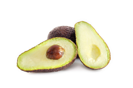 Avocado (also named as Persea americana, Lauraceae avocado, alligator pear, criollo fruit, Aguacate in Spanish, Abacate in Protugese, or avocado pear) isolated on white