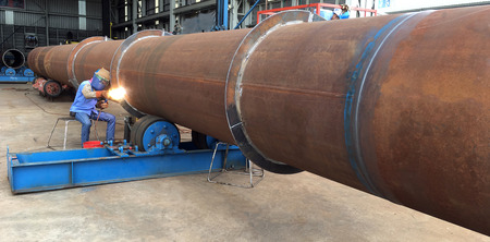 Welding technician weld big pipe work in oil and gas offshore industry in a fabrication yard