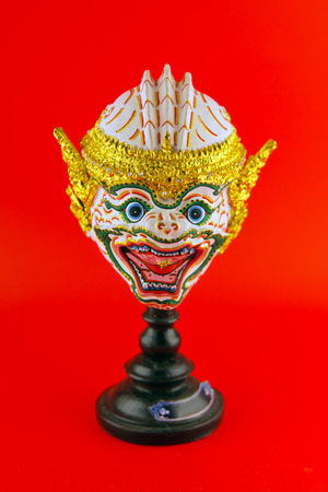 hua: Hua Khon (Ancient Thai Show Head Mask) use in Khon Thai classical style of Ramayana Story isolated on red background