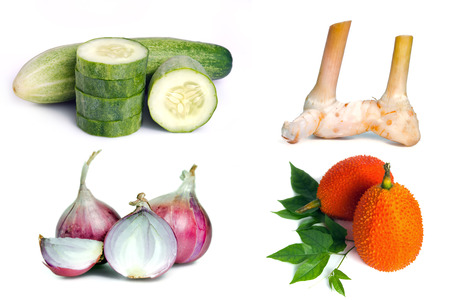 cucumis sativus: Cucumber, Ginger, shallot(onion), and gac fruit grouped and isolated on white background Stock Photo