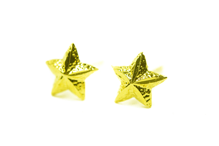 Gold pendant cameo earring jewellery with special Thai gold star shape design isolated on white background