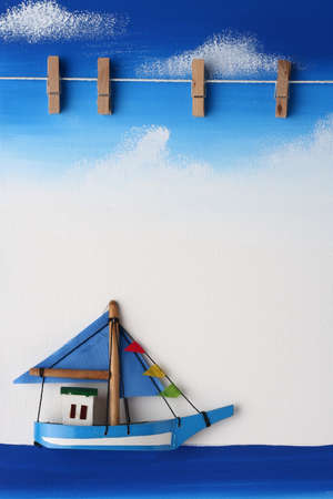 Picture Board with Wooden Paper Clip on Blue Sky, Ocean and Boat Drawing Background Stock Photo - 9280030