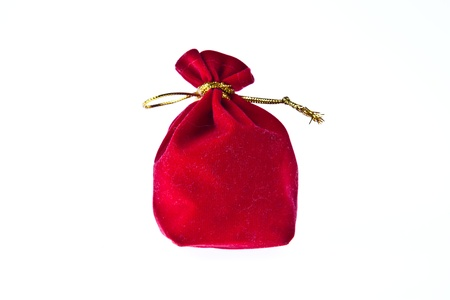 Red velvet pouch isolated on white background Stock Photo - 9558794