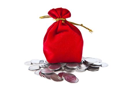 Red velvet pouch with coins isolated on white background photo