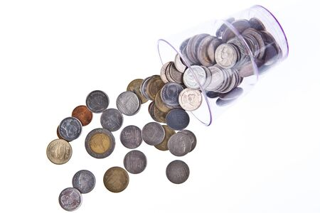 baht: Thai Baht coins falling from cup Stock Photo