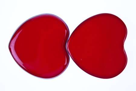 disclose: Two red hearts together isolated on white background