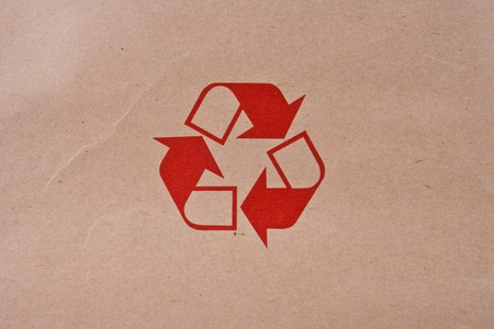 Recycled Symbol on Brown Paper Stock Photo - 9558654