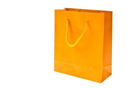 Orange paper bag isolated on white background Stock Photo - 9862689