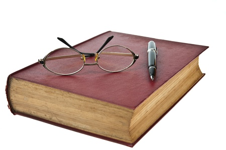 spines: Old books with eye glasses and pen isolated on white background Stock Photo