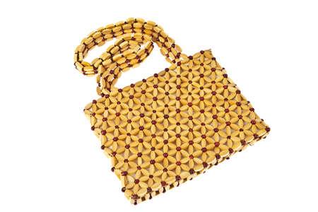 Beads handbag made from wood isolated on white background photo