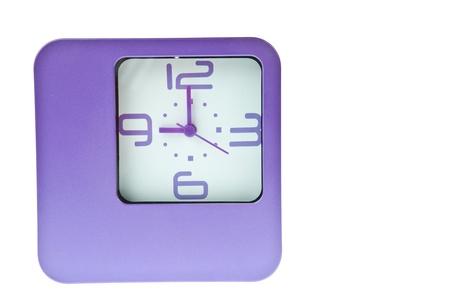 o�??clock: Reloj de mesa violeta en 9 Foto de archivo
