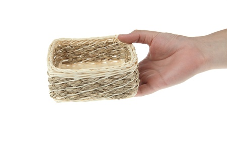 Wicker Box with hand isolated on white background photo