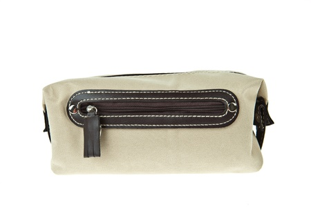 cream color travel bag isolated on white background photo