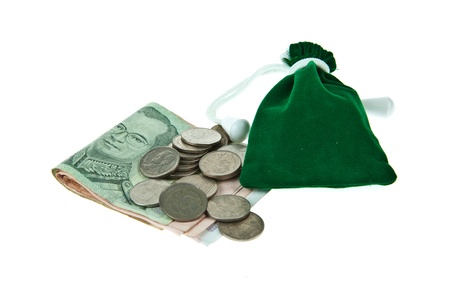 Green velvet pouch with coins and bank notes isolated on white background photo