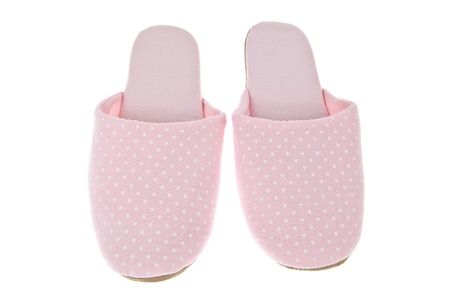Pink slippers isolated on white background photo